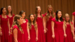 Red girls singing choir