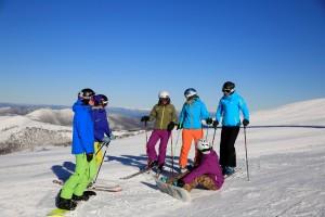 Girls snowsports tour on mountain top