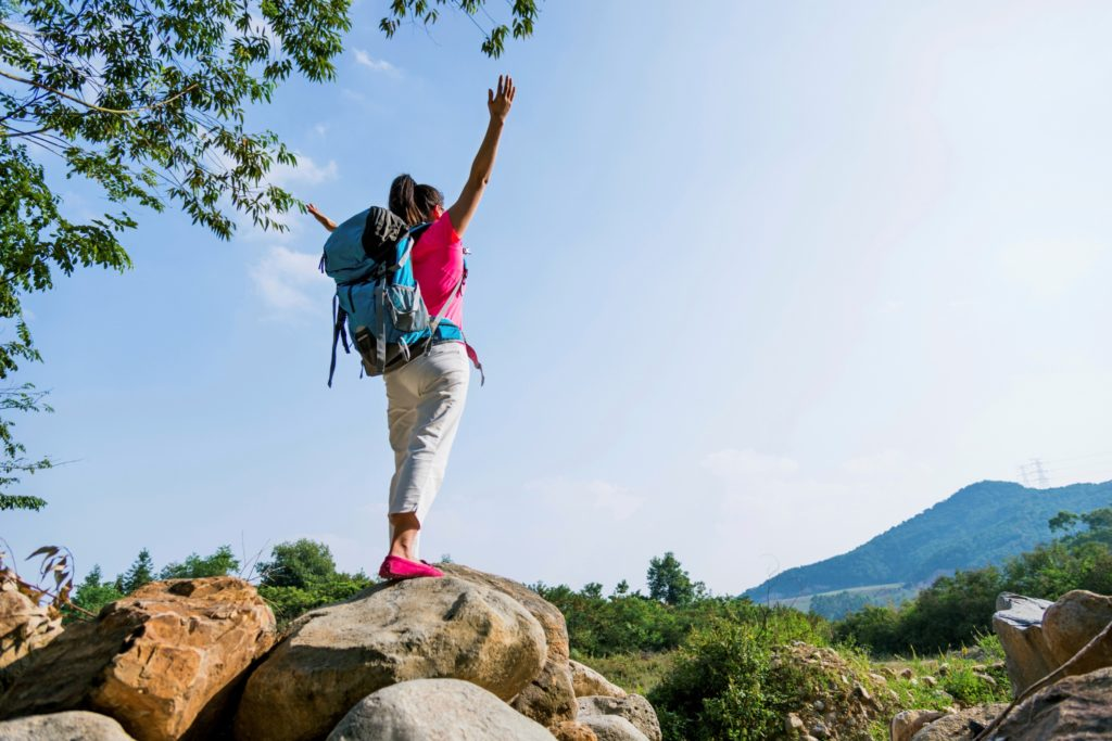 Female traveller on mountain top