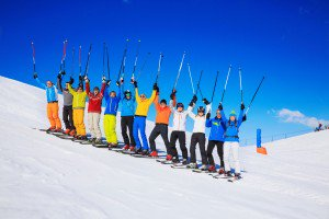 Excited skiiers on mountain top